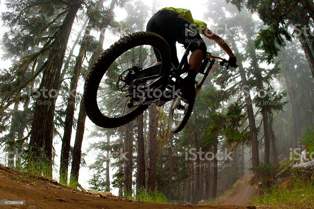 Mountain biker jumping on a trail stock photo