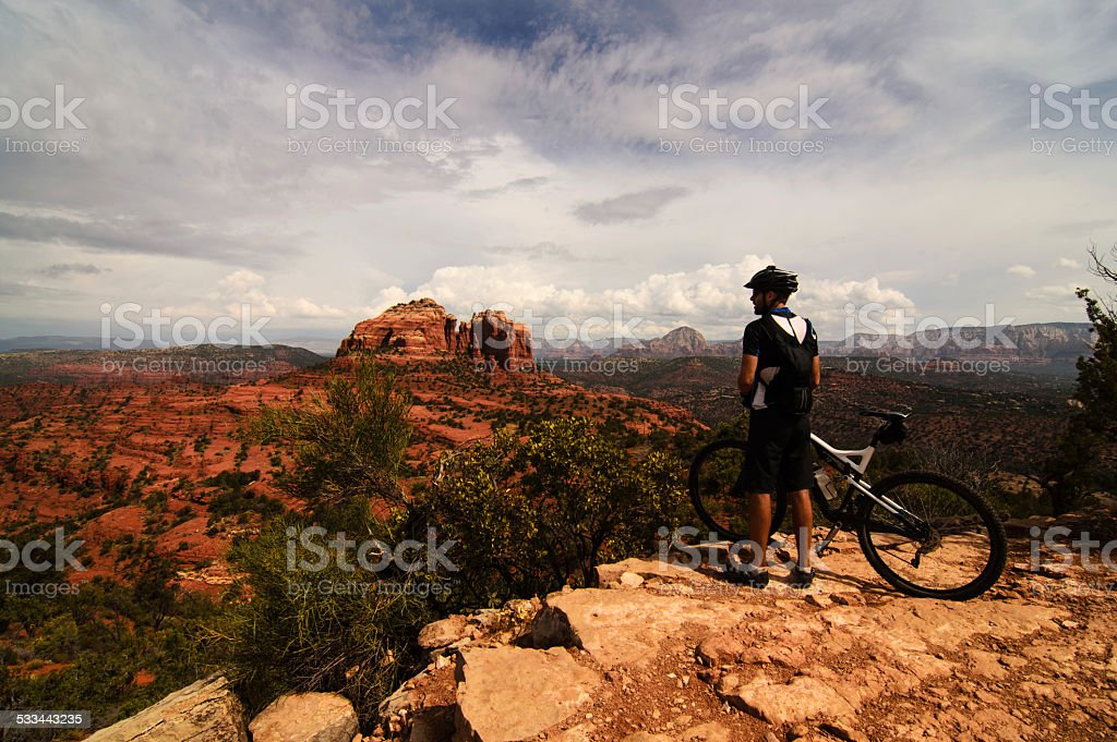 Mountain Biker Looking At a View stock photo