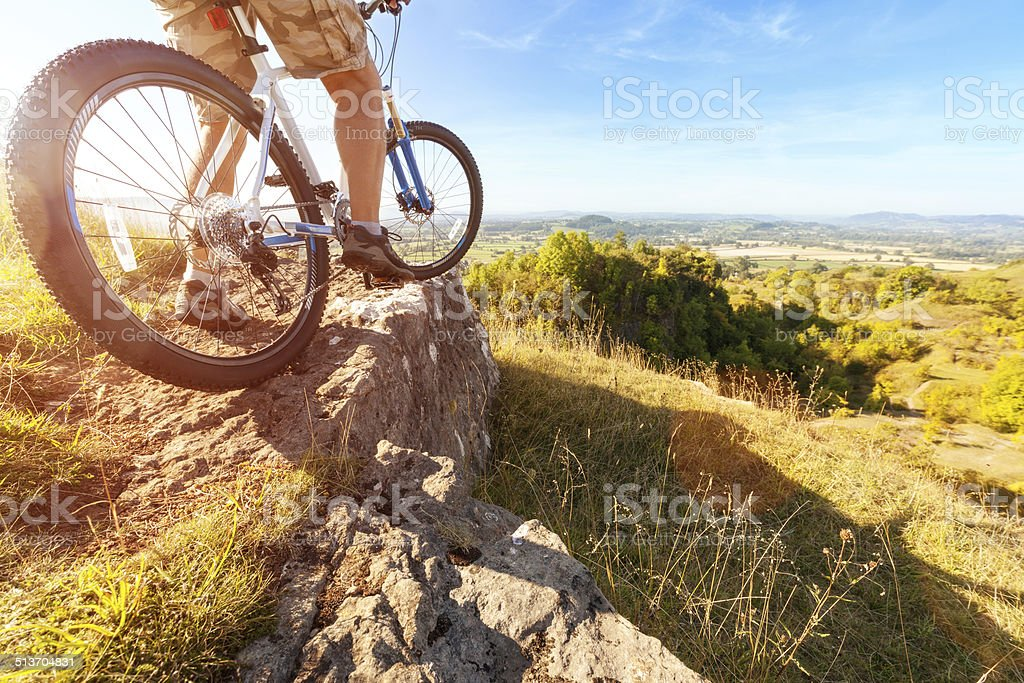 Mountain biker looking at downhill dirt track stock photo