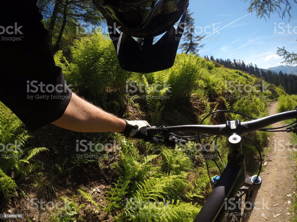 Mountain biker looking at his bike stock photo