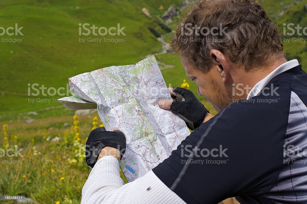 Mountain biker reading royalty-free stock photo