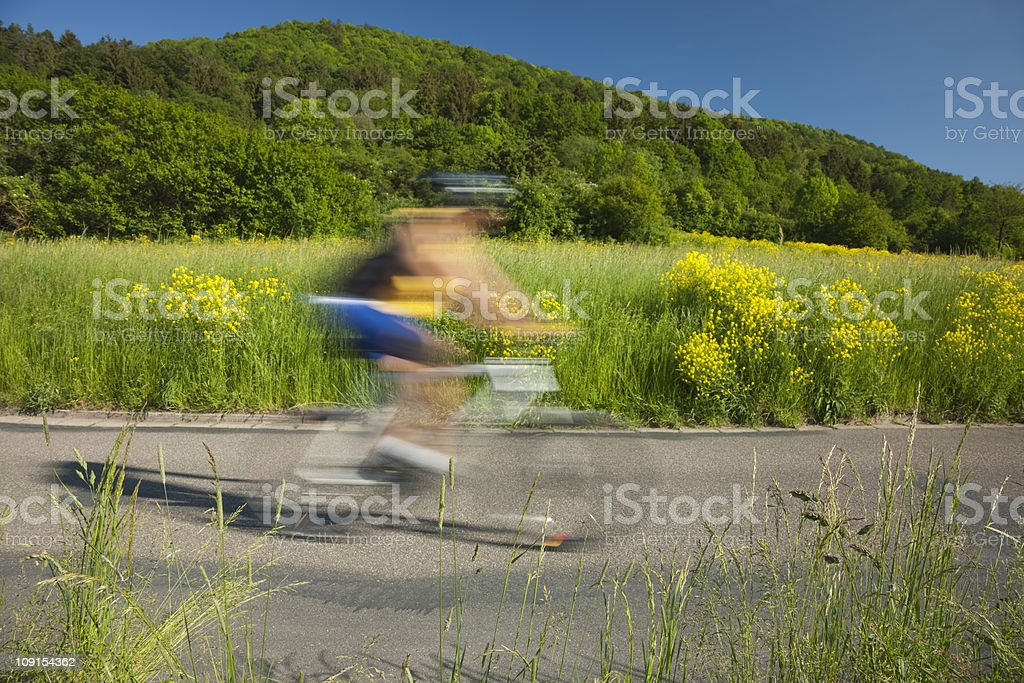 Mountain Biker Riding in Countryside royalty-free stock photo
