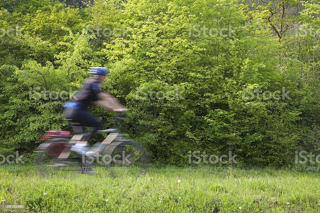 Mountain Biker Riding on Nature Trail royalty-free stock photo