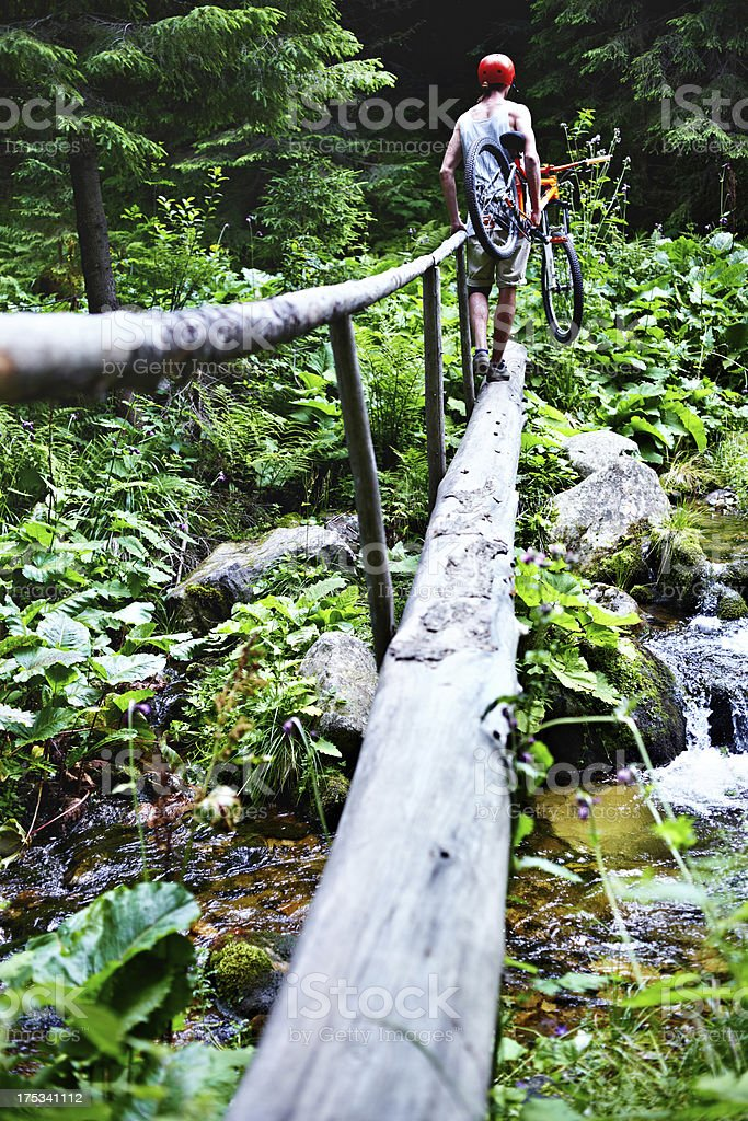 Mountain biker ?rossing the river stock photo