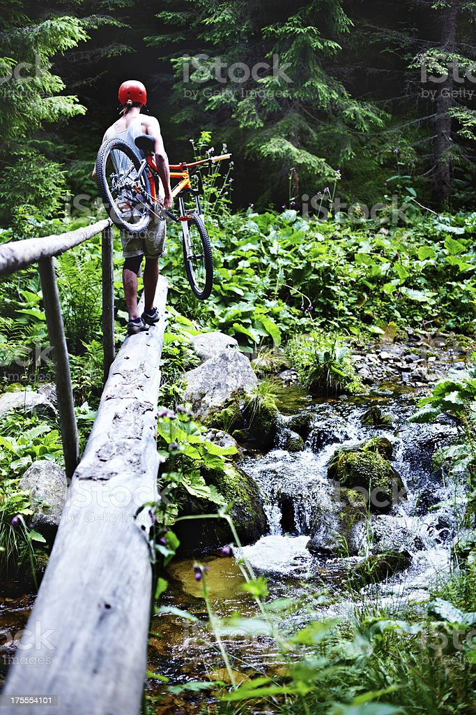 Mountain biker сrossing the river stock photo