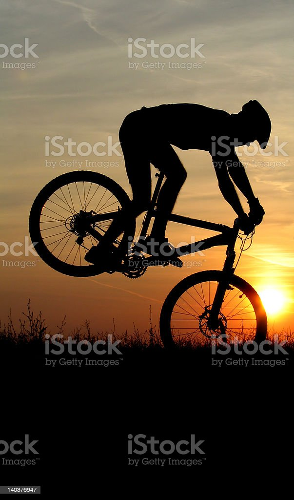 mountain biker silhouette in sunset royalty-free stock photo