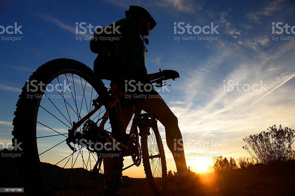 mountain biker sunset silhouette stock photo