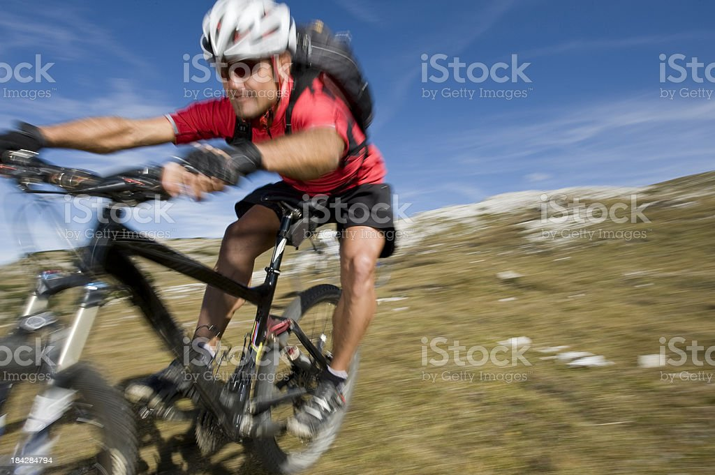 Mountain Biker with Blurred Background royalty-free stock photo