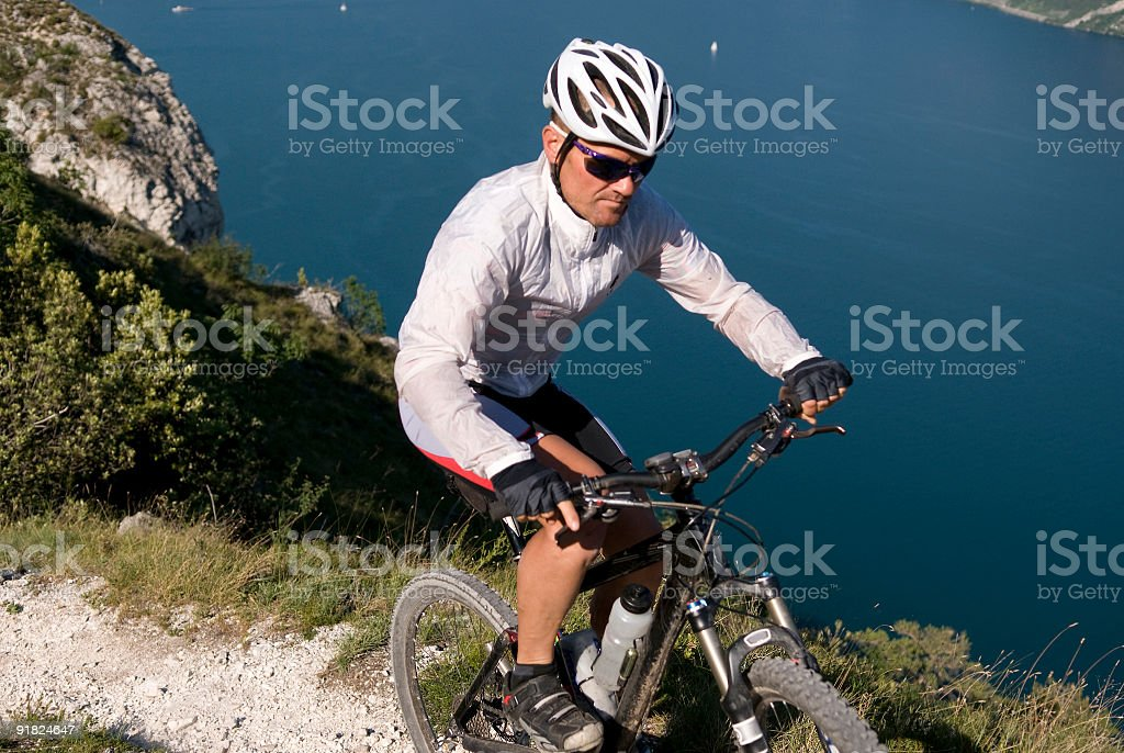 mountain biker with lake background royalty-free stock photo