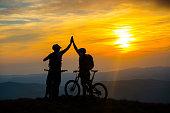 Mountain Bikers Giving High Five