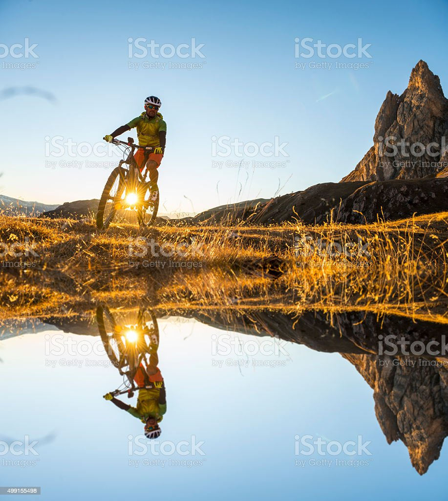 Mountain bikers on the lake stock photo