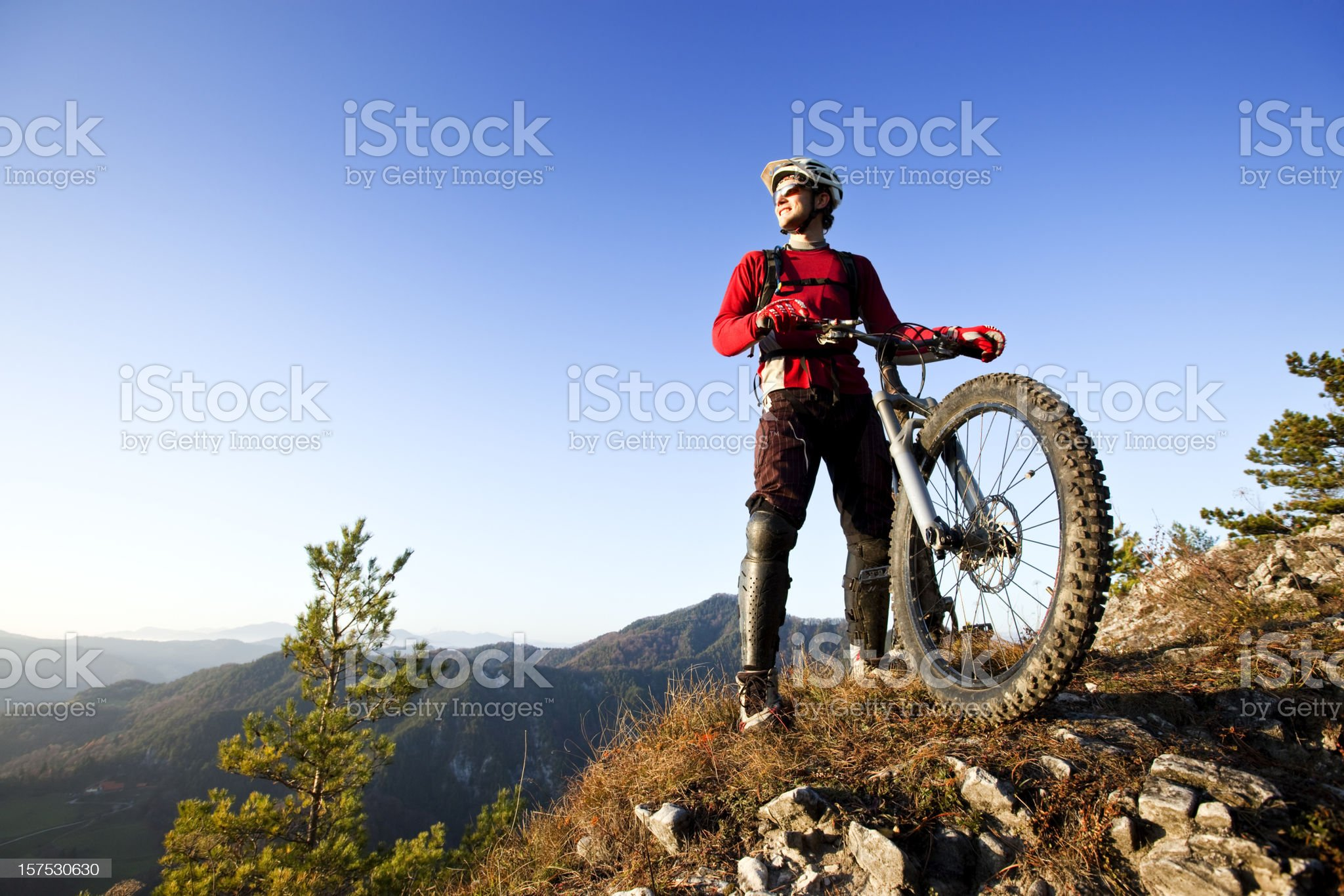 Mountainbiker on top royalty-free stock photo