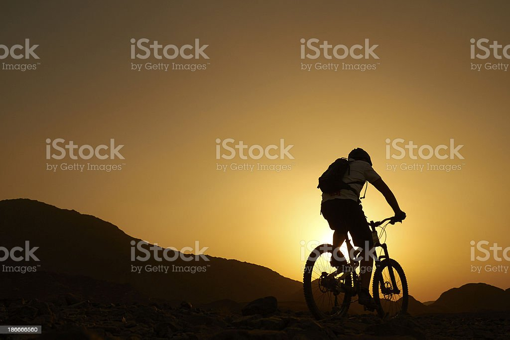 Mountain Biking At Sunset stock photo