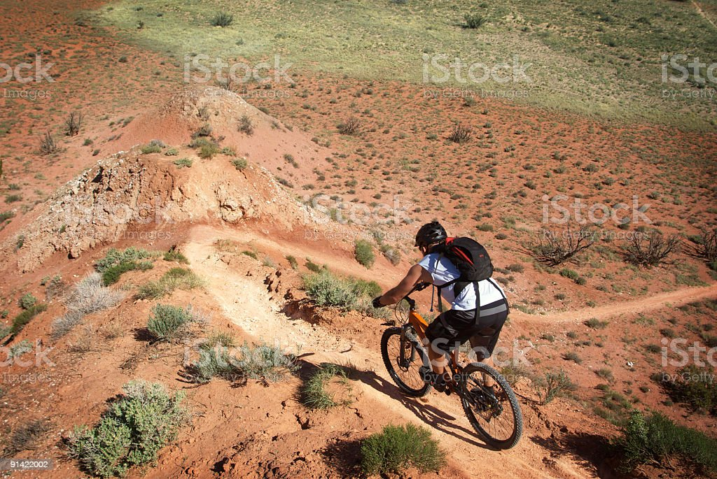 mountain biking: descending steep desert singletrack landscape royalty-free stock photo