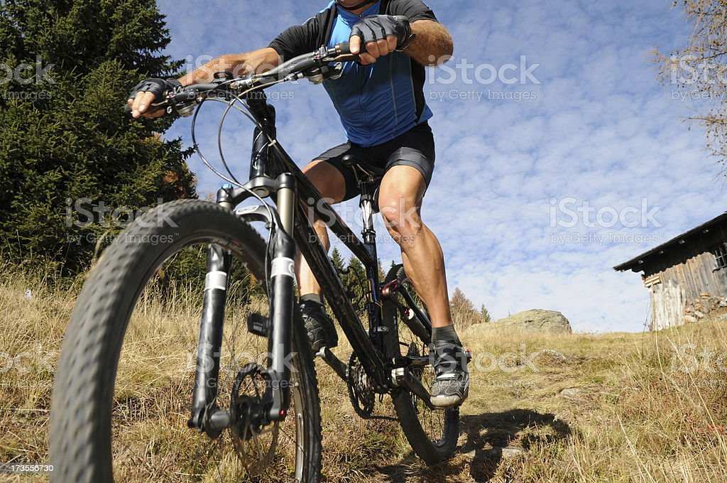 Mountain biking in action stock photo