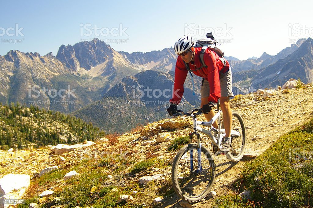Mountain biking in high alpine mountains stock photo