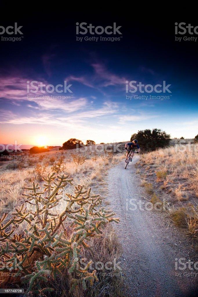 mountain biking intense sunset landscape stock photo