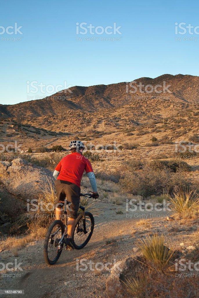 mountain biking man and sunset landscape royalty-free stock photo