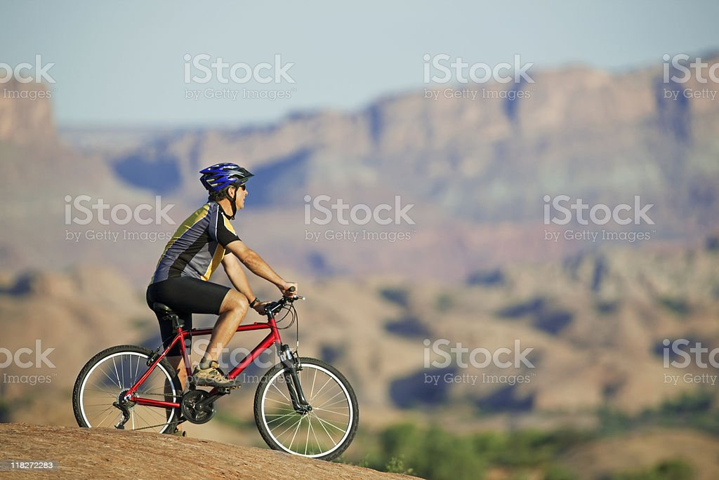 Mountain Biking On Rugged Terrain In Moab, Utah royalty-free stock photo