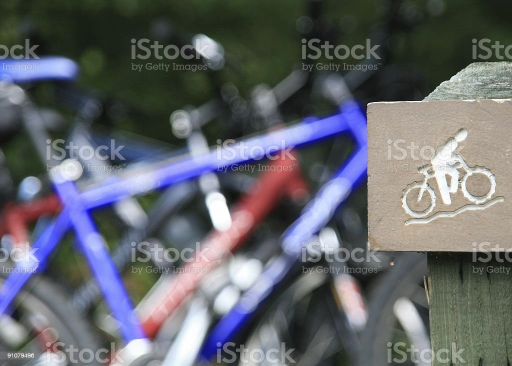 Mountain Biking Sign and Bikes in Background royalty-free stock photo