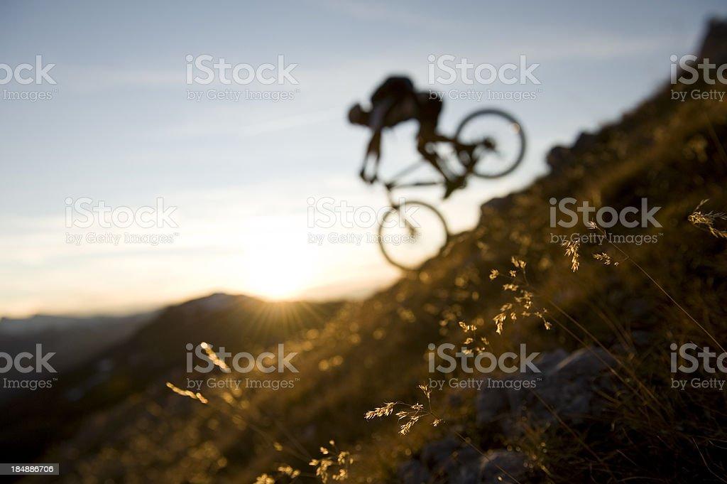 mountain biking sunset silhouette stock photo