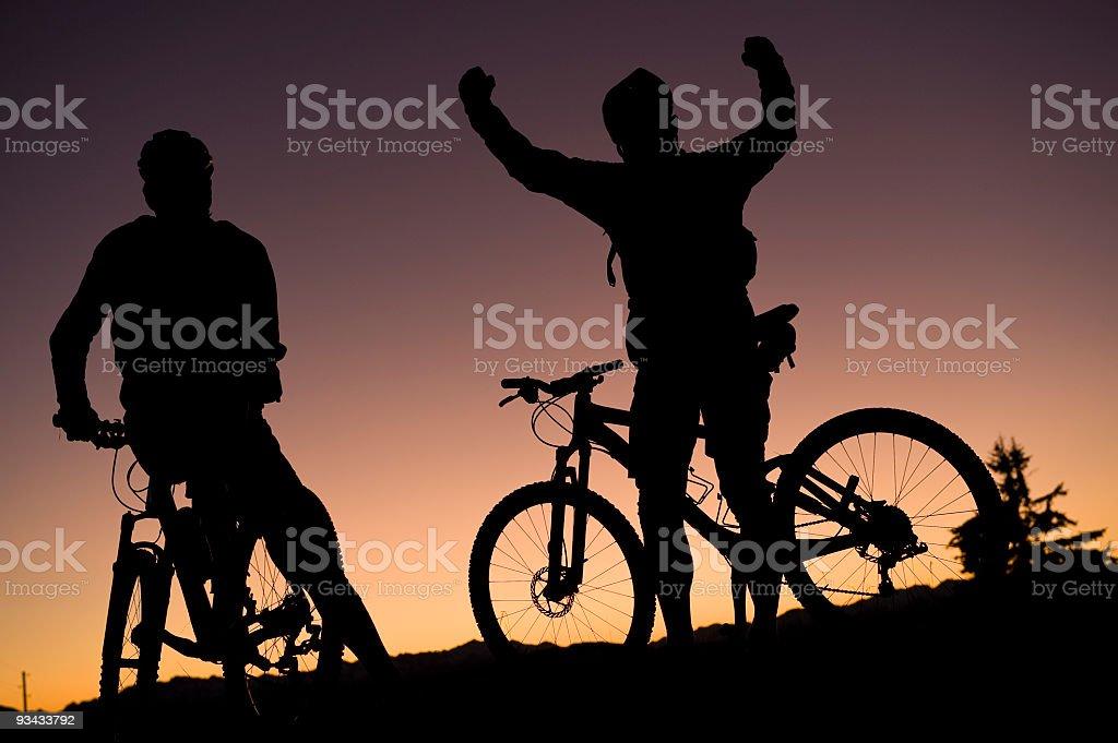 mountain biking team silhouette stock photo