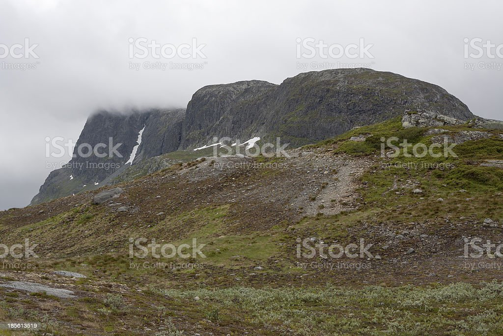 Mountain Bitihorn covered with clouds (Jotunheimen, Norway) stock photo