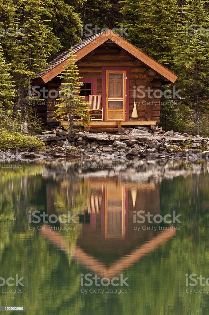 Mountain Cabin in Reflection stock photo