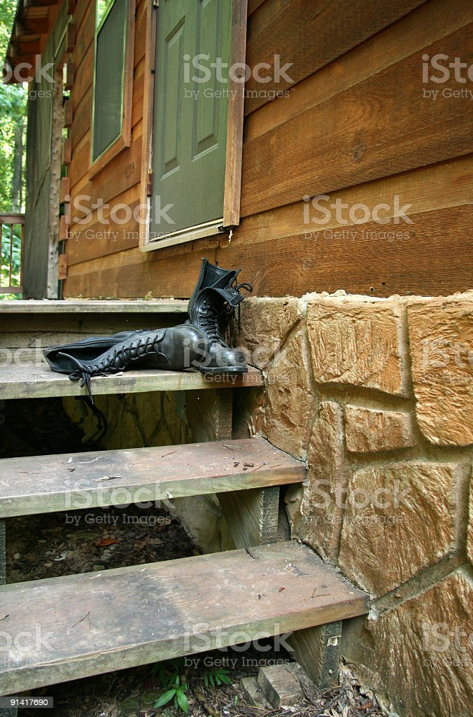 Mountain cabin in Tennessee and motorcycle boots royalty-free stock photo