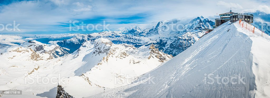 Mountain cable car station high on snowy Alpine peak Switzerland stock photo