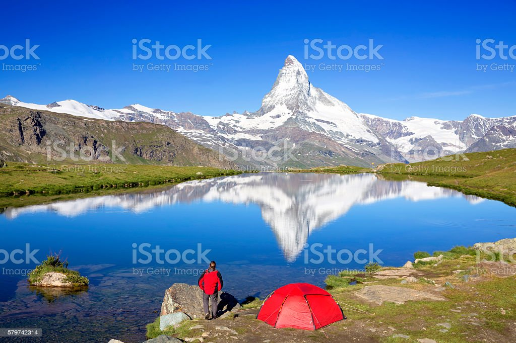 Mountain camping at sunny day with view to Matterhorn stock photo