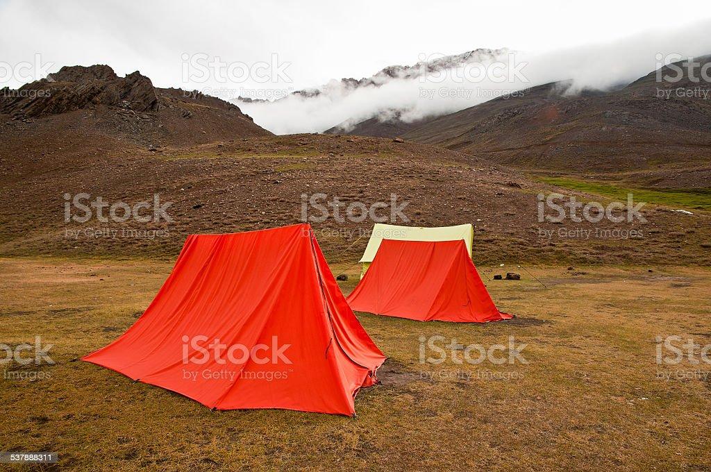 Mountain camping in adventurous terrain stock photo