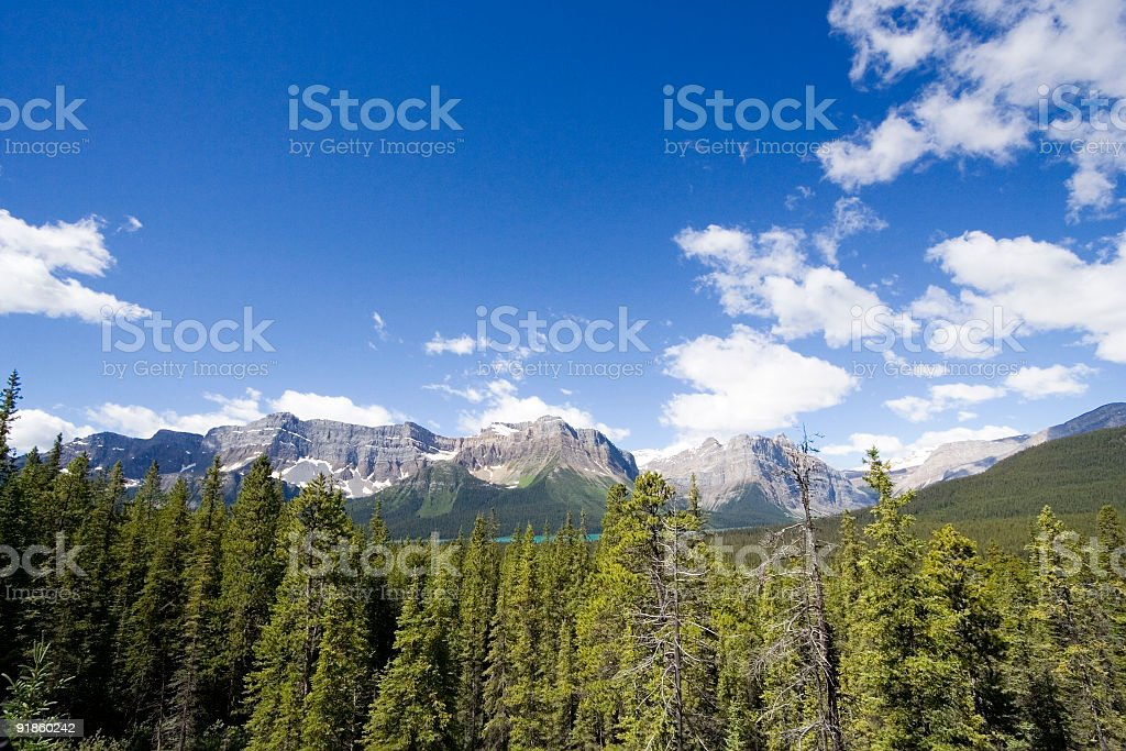 mountain chain and sky in the rockies stock photo