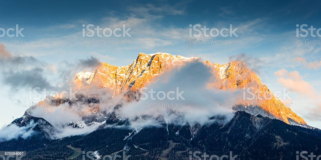 mountain chain wetterstein in tirol with lighted summit at sunset stock photo