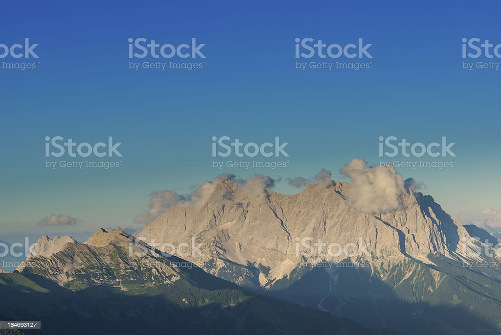 mountain chain with clouds and blue sky royalty-free stock photo