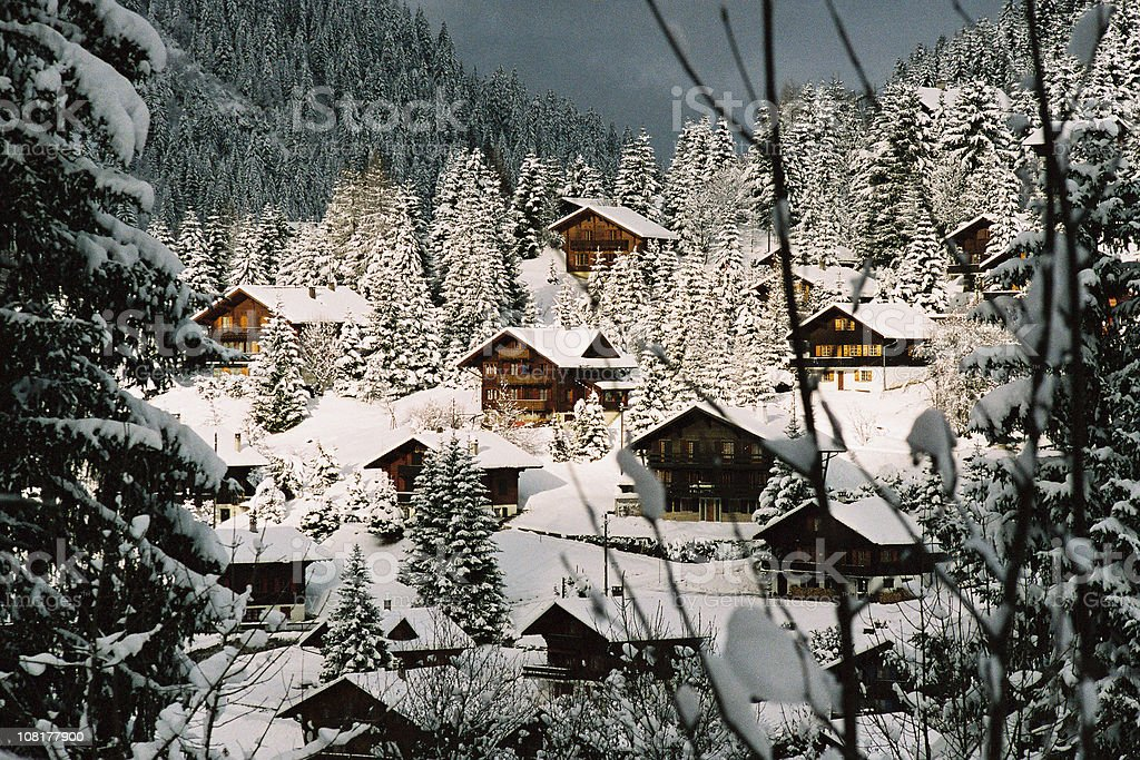 Mountain Chalets Covered in Snow stock photo