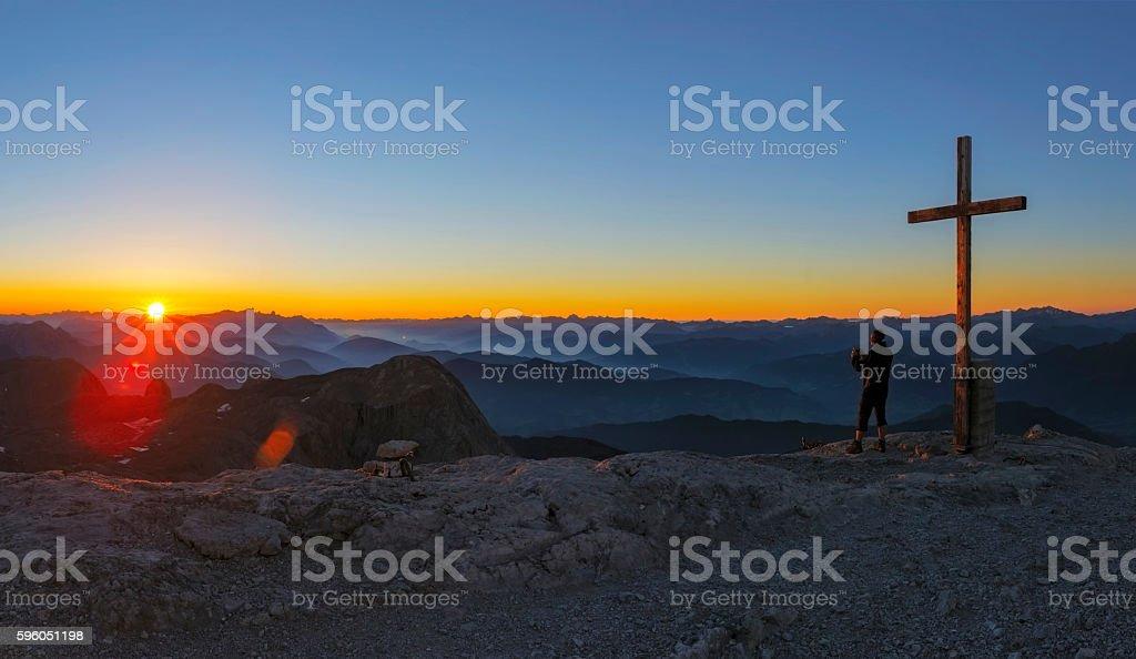 Mountain Climber at Sunrise take picture at Mountain Hochkönig stock photo