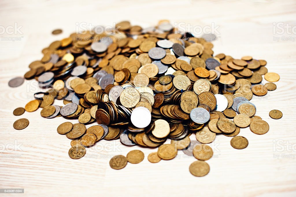 Mountain coins on wooden background stock photo