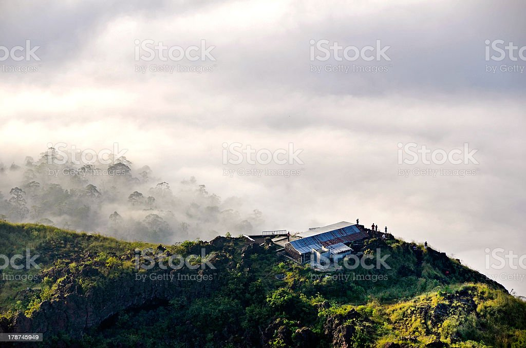 Mountain cottage above clouds with a jungle stock photo