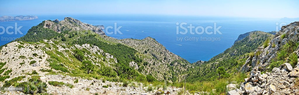 Mountain crest and ocean panorama stock photo