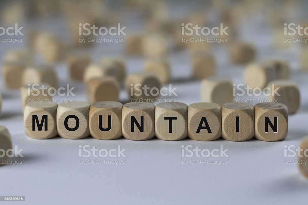 mountain - cube with letters, sign with wooden cubes stock photo