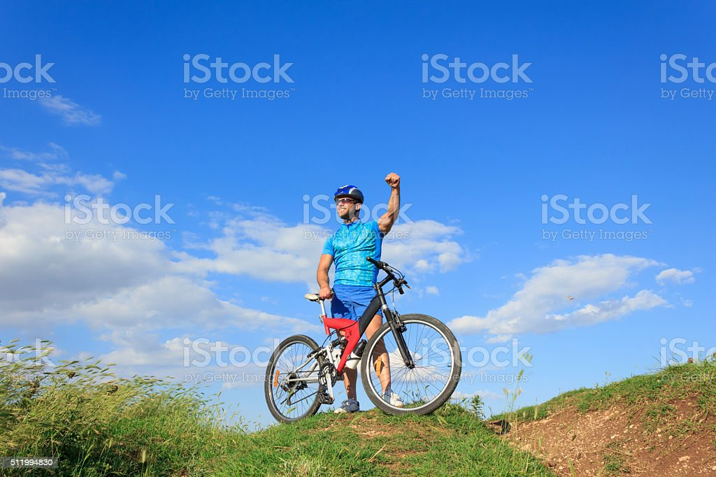 Mountain cycling on top of the hill stock photo