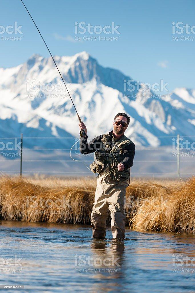 Mountain Fly Fisherman stock photo