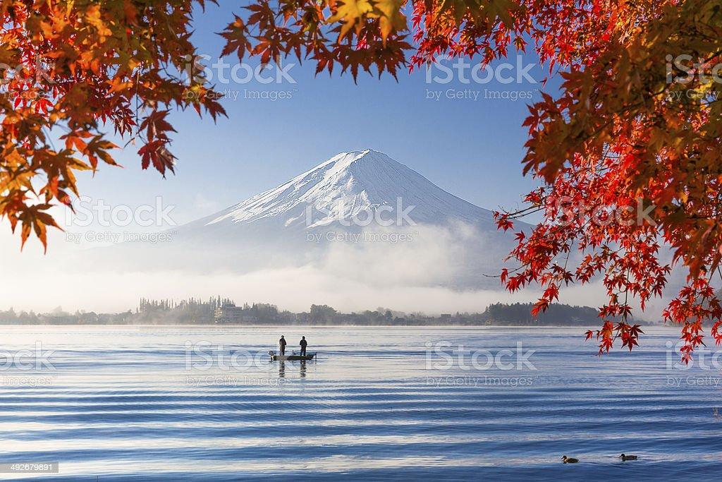 Mountain Fuji and lake with morning fog in autumn season stock photo