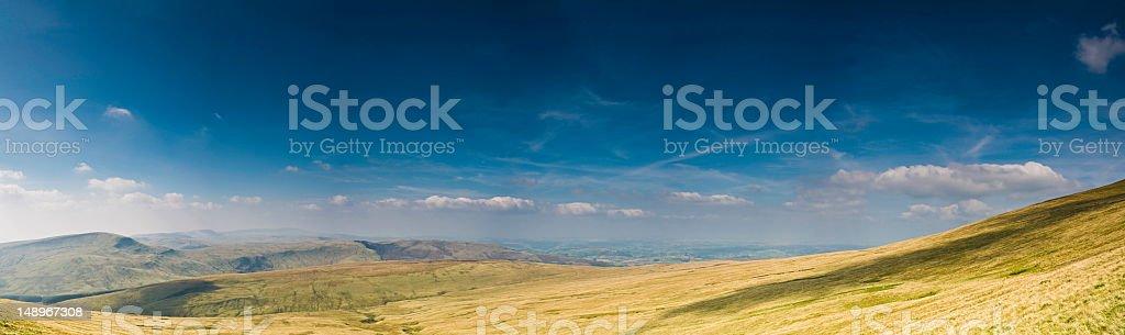 Mountain grasslands big sky blue royalty-free stock photo