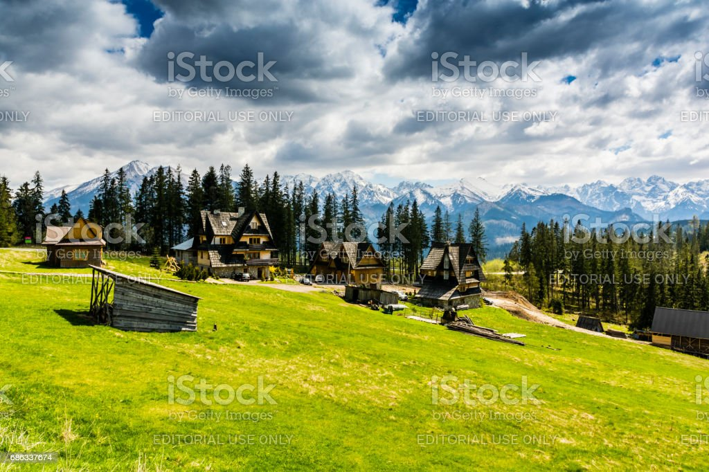 Mountain homes in glade with beautiful mountain views. stock photo