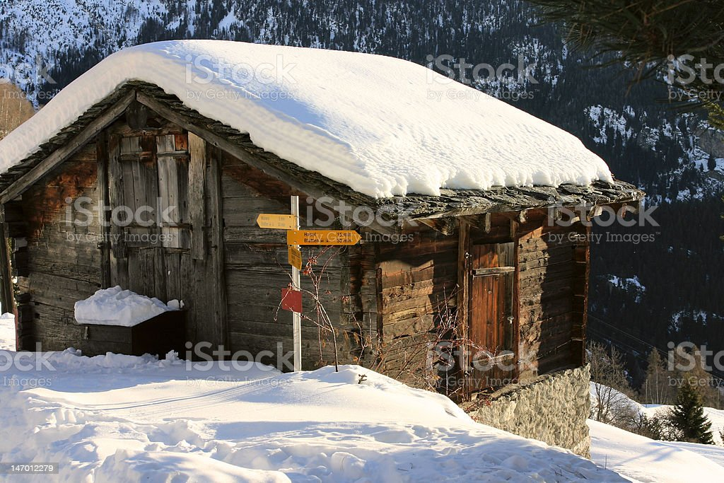Mountain hut covered by snow royalty-free stock photo