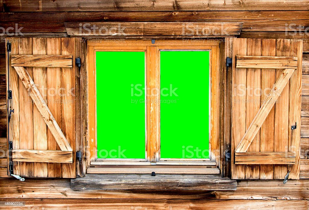 mountain hut window green screen stock photo