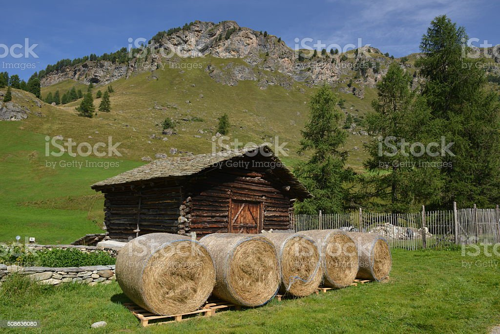 Mountain Hut with Hay Rolls stock photo
