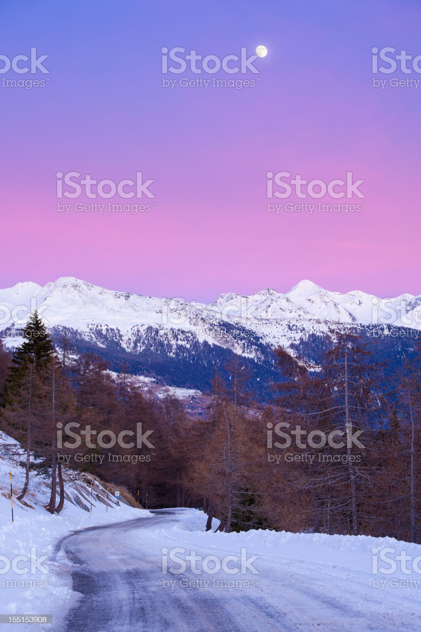 Mountain icy road at sunset royalty-free stock photo
